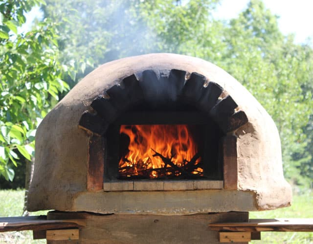 A backyard bread and pizza oven is another wonderful way to cook and bake outdoors | Rootsy
