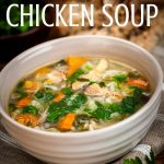 white bowl of homemade chicken soup with vegetables