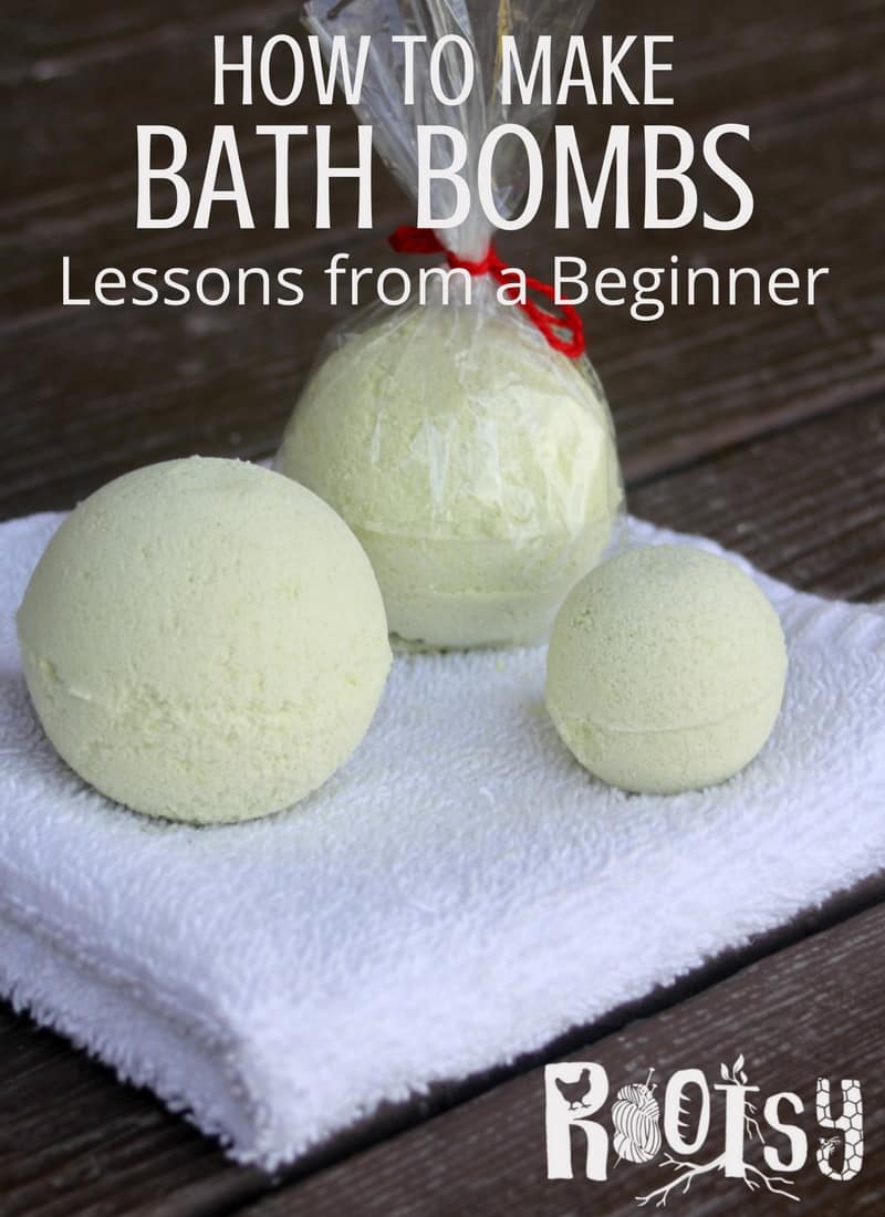 3 bath bombs of various sizes sitting on a white washcloth with text overlay stating: how to make bath bombs, lessons from a beginner.