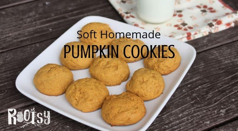 Soft homemade pumpkin cookies on a plate with a napkin and glass of milk.