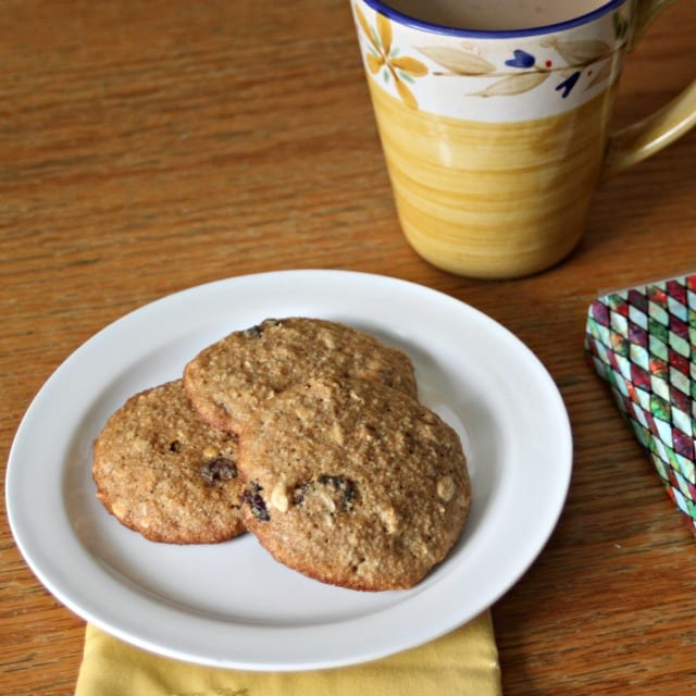 Oatmeal Raisin Breakfast Cookies on a plate with a cup of coffee.