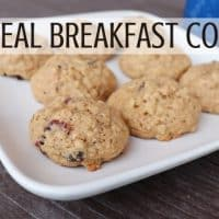 A plate full of cookies with text overlay stating oatmeal breakfast cookies.