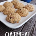 Cookies on a white plate with a blue cup in the background with text overlay stating: oatmeal breakfast cookies.