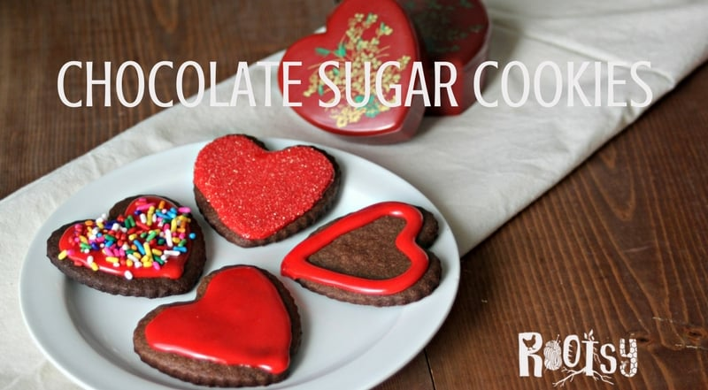 An easy and delicious chocolate sugar cookie recipe perfect for gift giving and having with tea as an afternoon snack. These are perfect plain but also serve as a great canvas for decorating with frosting, sprinkles, and more | Rootsy.org
