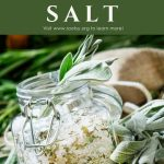 An open square shaped jar full of salt and dried herbs, surrounded by fresh herbs with a text block reading: how to make herbal salt.