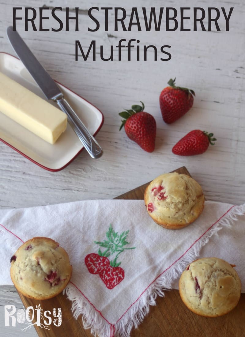 Fresh Strawberry Muffins on a table with butter and strawberries. Make the most of juicy berries by whipping up these quick and easy fresh strawberry muffins for breakfast and snack time.