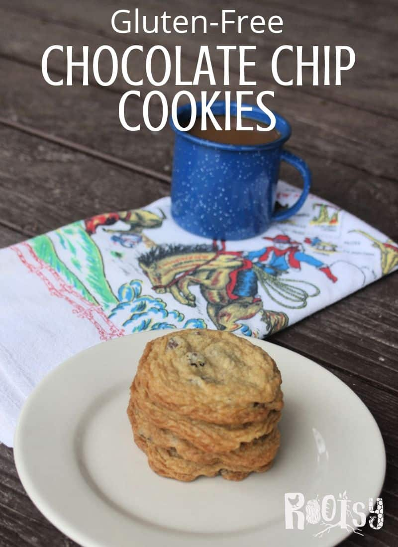 Gluten free chocolate chip cookies stacked on a plate with a napkin and cup of coffee.