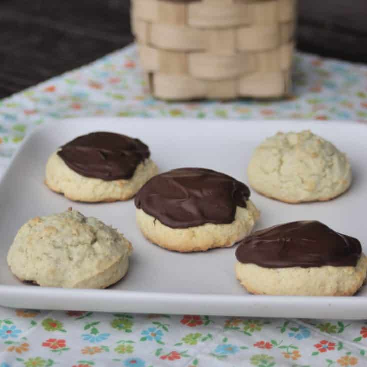 Gluten free sour cream cookies on a square plate.