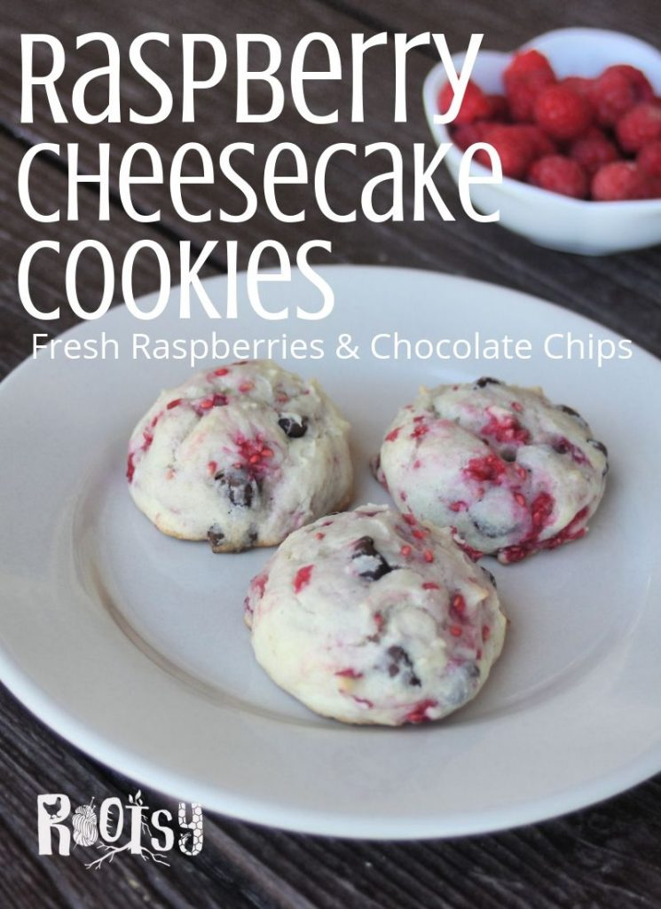 Raspberry cheesecake cookies on a plate with text overlay and a small bowl of fresh raspberries.