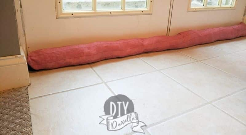 image of pink door draft stopper also called a door snake