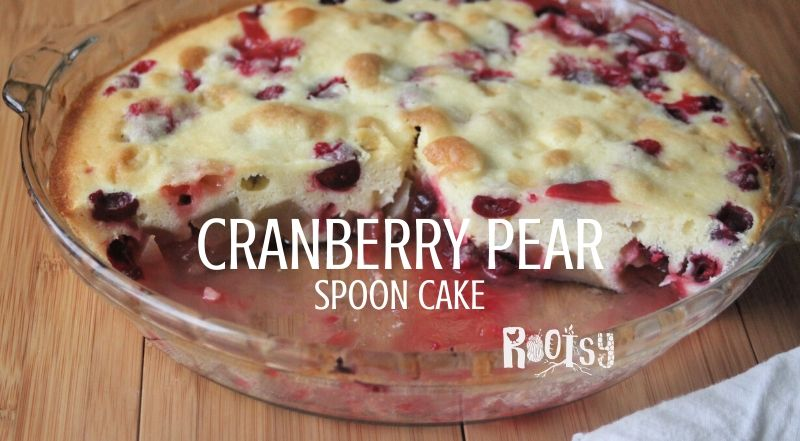 Cranberry pear spoon cake in a glass pie plate with text overlay.