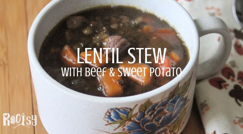 A cup of lentil stew with a napkin and text overly.