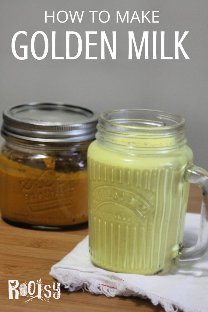 A glass mug of golden milk tea sitting on a white napkin with a jar of golden milk paste sitting behind it and text overlay.