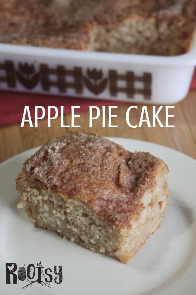 A slice of apple pie cake on a plate with text overlay.