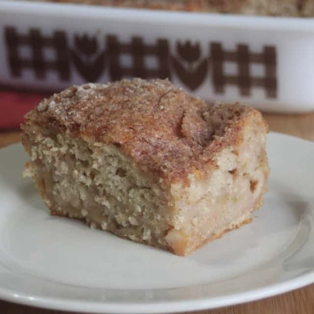 A slice of apple pie cake on a plate.