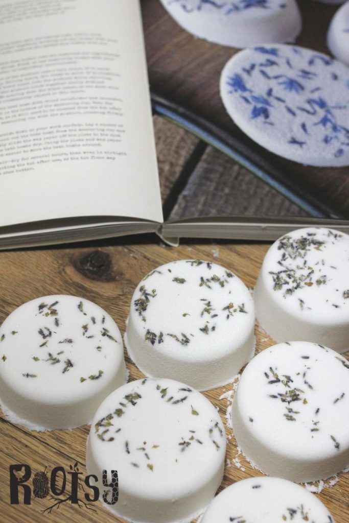 lavender milk bath bombs on wooden table with herbal boom