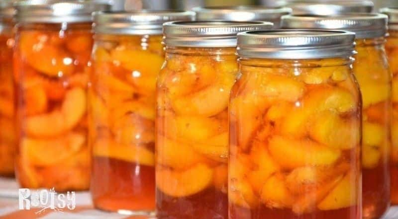 jars of canned peaches in simple syrup