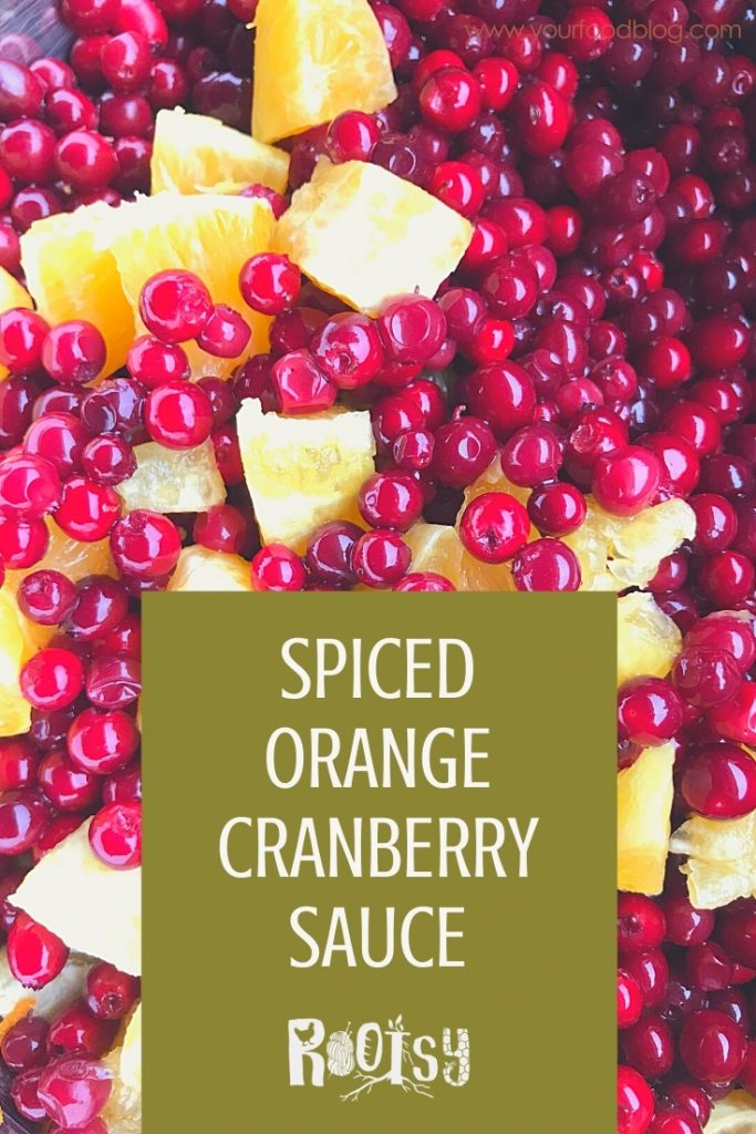 """Cranberries and sliced oranges graphic with """"Spiced Orange Cranberry Sauce Recipe and Canning Instructions"""" written on it."""