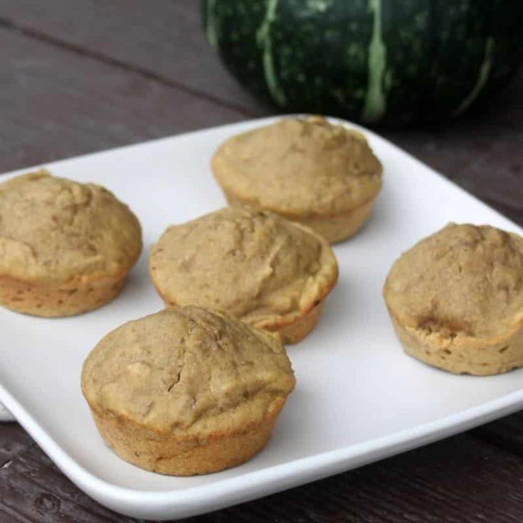 5 Pumpkin lentil muffins on a white plate.