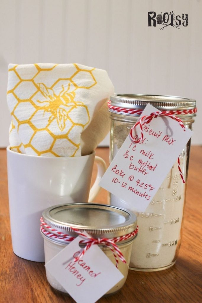 get set of creamed honey with biscuit mix in a jar and a mug with a tea towel