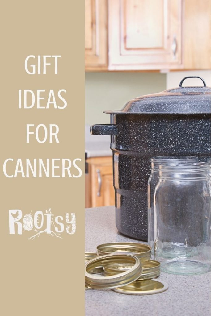 A water bath canner pot with empty glass jars and canning rings on a kitchen counter with text overlay reading gift ideas for canners.