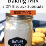 Biscuit baking mix in a mason jar with biscuits in a cast iron pan in the background