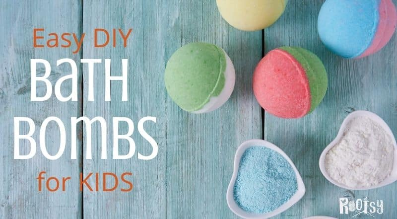 colorful bath bombs for kids on a blue wooden background
