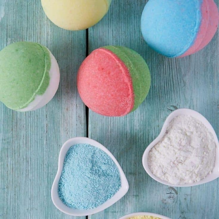 colorful bath bombs for kids on blue background