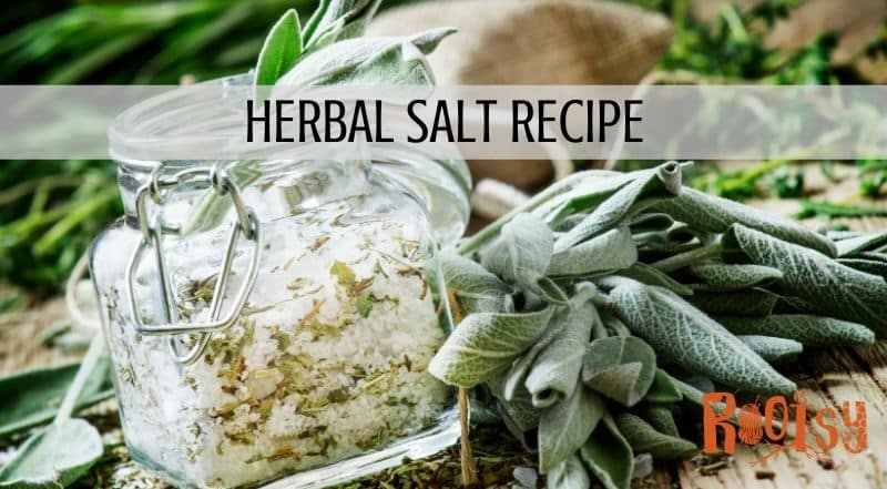 An open square shaped jar full of salt and dried herbs, surrounded by fresh herbs with a text block reading: herbal salt recipe.