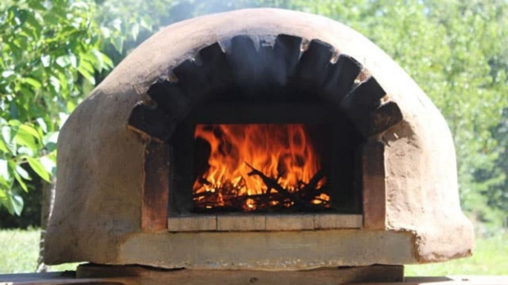 Cooking outside in a brick oven and how to build an inexpensive outdoor pizza oven