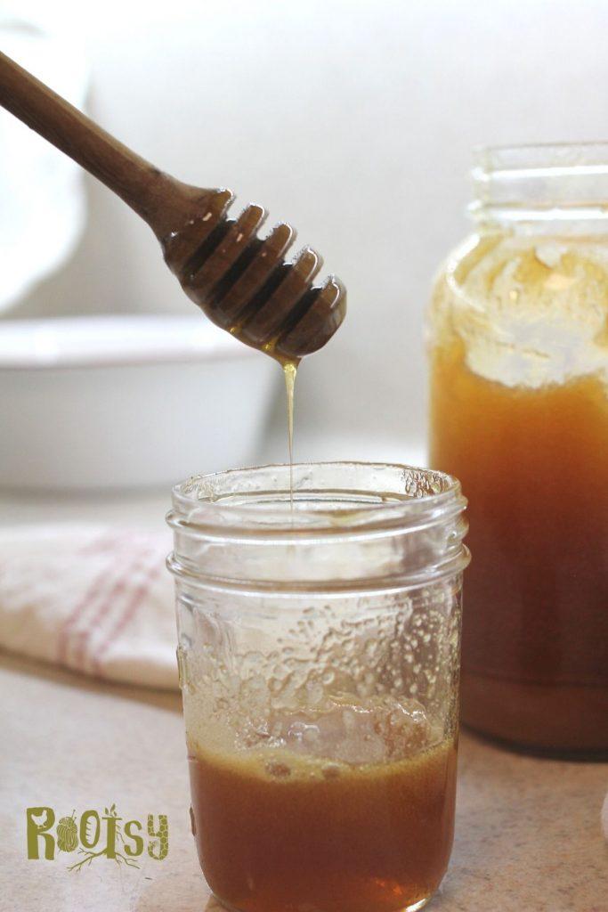 decrystallized hone on honey dipper