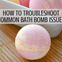 A bath bomb on a bamboo mat with text overlay reading: how to troubleshoot common bath bomb issues.